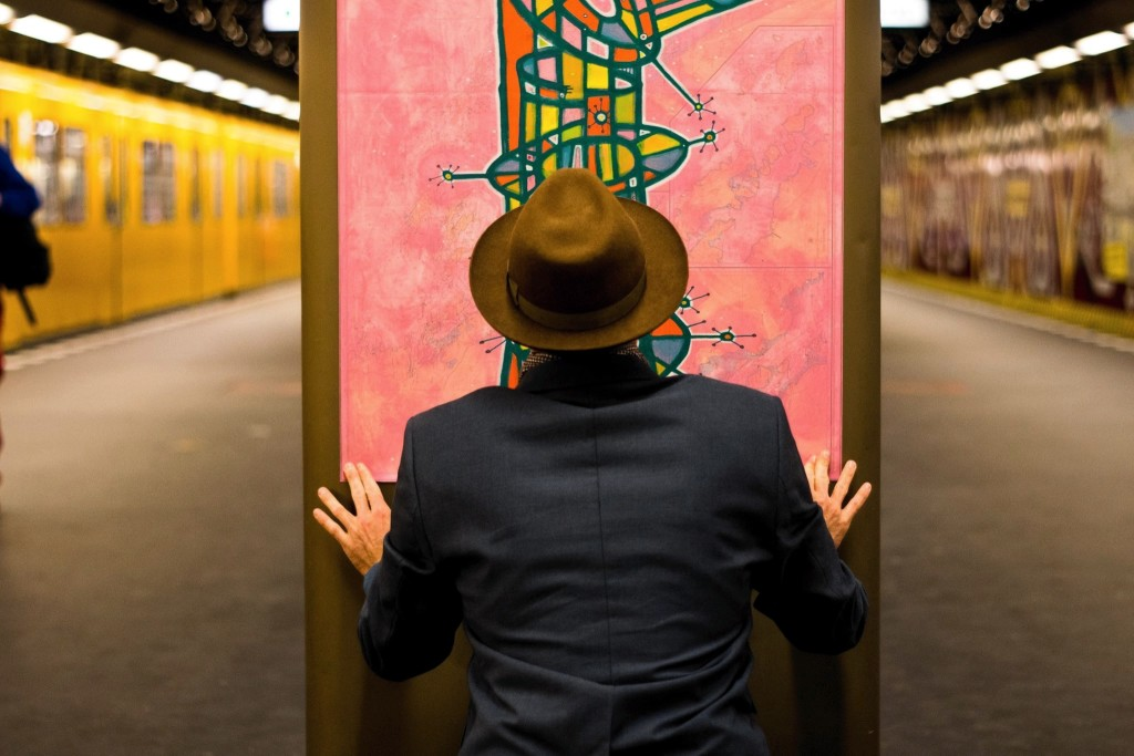 John putting up his artwork in Berlin's subway for a public exhibition.